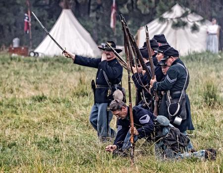 period costume: Union advance in combat    at a Civil War reenactment in Graeagle, California.