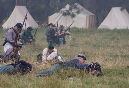 under fire: Confederates under fire at a Civil War reenactment at Graeagle, California. Editorial