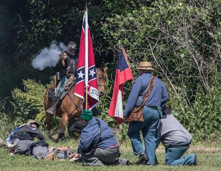 red bluff: Confederates defend against a cavalry scout   at Dog Island  Civil War Reenactment, Red Bluff, California
