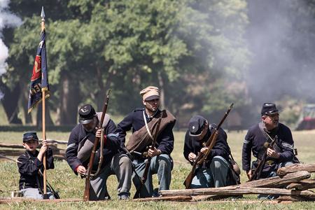 red bluff: Union soldiers return fire   at Dog Island  Civil War Reenactment, Red Bluff, California