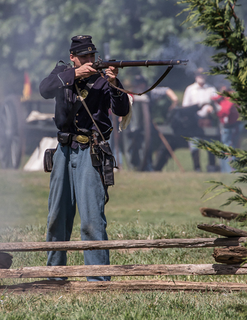 Union soldier takes aim  Cannon crew fights back  at Dog Island  Civil War Reenactment, Red Bluff, California Editorial