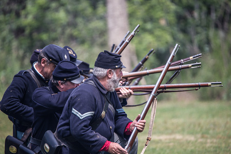red bluff: Union infantry in combat at a Civil War Reenactment, Red Bluff, California