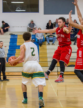 klamath: Basketball action with Klamath Falls (red) against paradise in Redding, California.