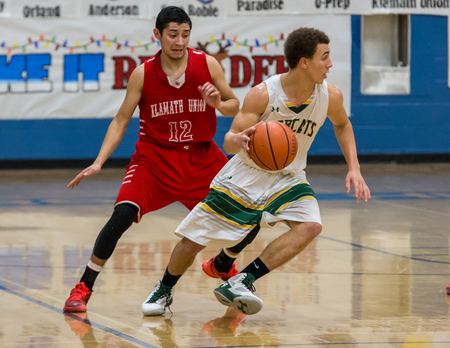 Basketball action with Klamath Falls (red) against paradise in Redding, California.