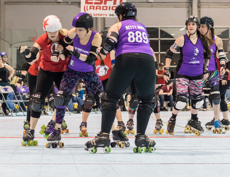 rollerskating: Roller derby action with Red Bluff Derby Girls (red) and Shasta Roller Derby girls in Redding, California. Editorial