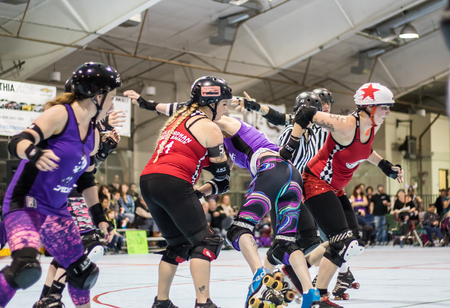 rollerskating: Roller derby action between Red Bluff (red)  and Shasta in Redding, California. Editorial