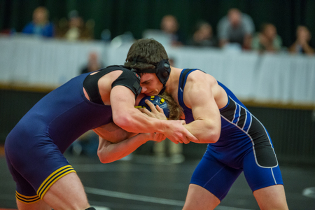 championships: Two wrestlers on the mat against each other in the NCSIF Wrestling Championships in northern California.