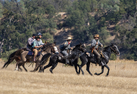 cavalry: Cavalry scouts at war in a Civil War reenactment at Hawes Farm in Anderson, California. Editorial