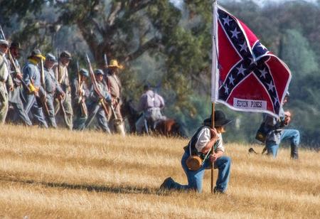 reenactment: Confederates in combat at the Hawes Farm Reenactment in Anderson, California.