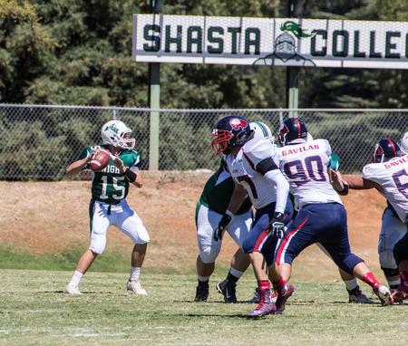 American football game with Gavilan vs. Shasta College (green). Sept 5th, 2015 Redding, California. Editorial