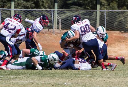gavilan: American football game with Gavilan vs. Shasta College (green). Sept 5th, 2015 Redding, California. Editorial