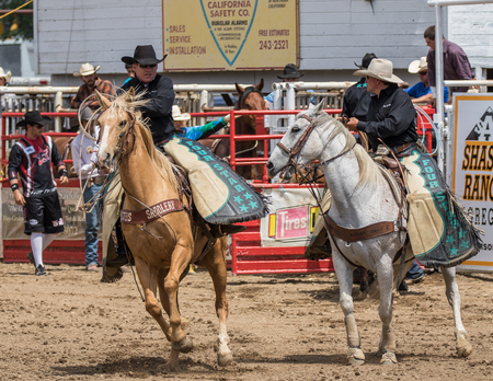 arena rodeo: Cowboys at the rodeo in Cottonwood, California. Editorial