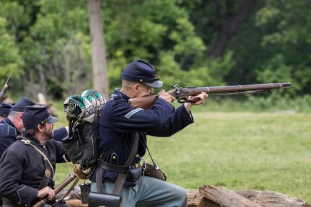 Civil War reenactors in battle  at the Dog Island Reenactment in Red Bluff, California. Stock Photo - 57382464