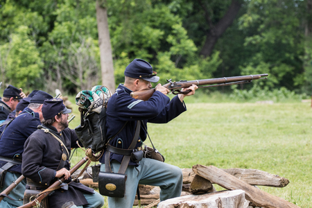 Civil War reenactors in battle  at the Dog Island Reenactment in Red Bluff, California. Stock Photo - 57382466