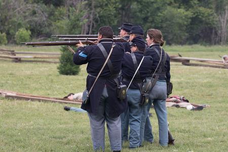 Civil War reenactors in battle  at the Dog Island Reenactment in Red Bluff, California. Stock Photo - 57382468
