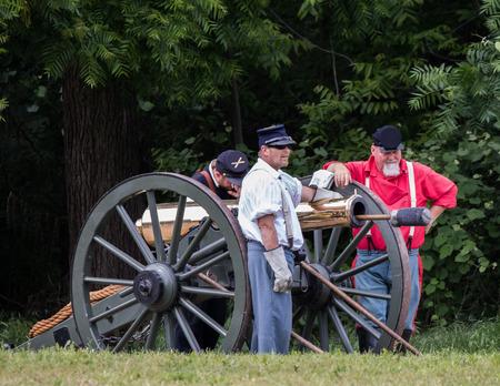 period costume: Civil War reenactors in battle  at the Dog Island Reenactment in Red Bluff, California.