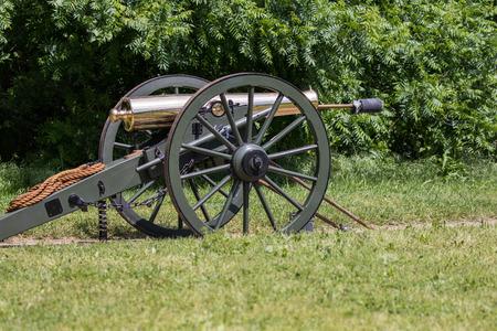 period costume: Civil War cannon at the Dog Island Reenactment in Red Bluff, California.