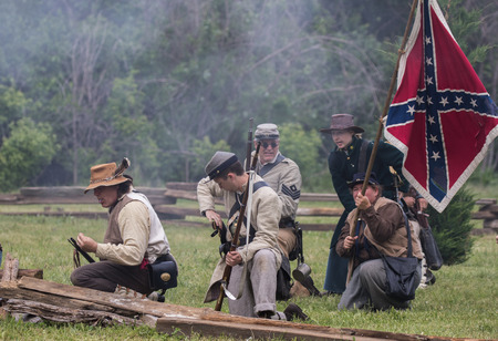 Civil War reenactors in battle  at the Dog Island Reenactment in Red Bluff, California. Stock Photo - 57382503
