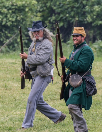 Civil War reenactors in battle  at the Dog Island Reenactment in Red Bluff, California.