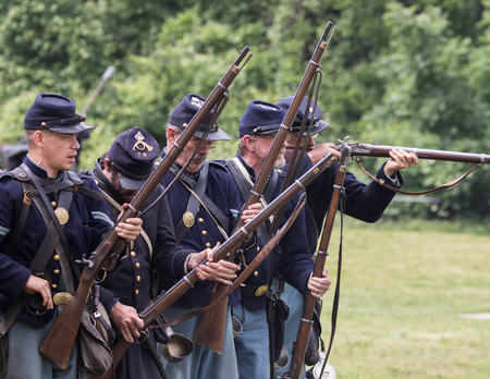 Civil War Union soldiers at the Dog Island reenactment in Red Bluff, California. Stock Photo - 57382527