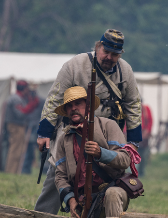 Civil War reenactors in battle  at the Dog Island Reenactment in Red Bluff, California.