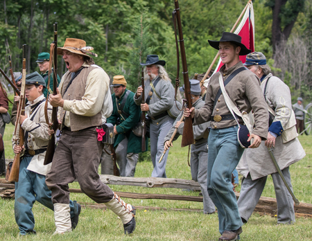 Civil War soldiers in action at  the Dog Island reenactment in Red Bluff, California. Stock Photo - 57382787