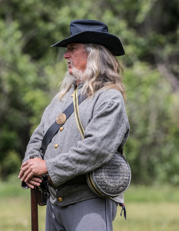 reenactor: Civil War reenactor at the Dog Island reenactment in Red Bluff, California.