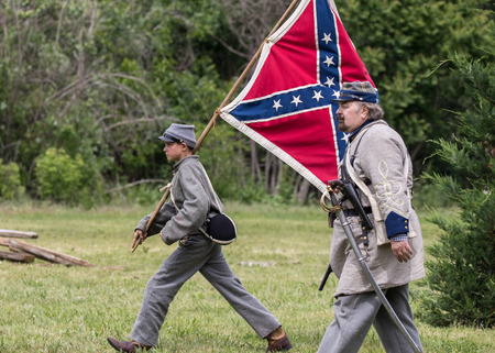 Civil War soldiers in action at  the Dog Island reenactment in Red Bluff, California. Stock Photo - 57382790