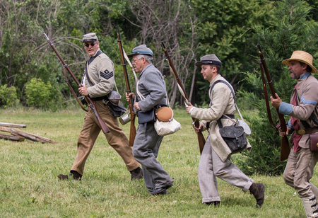 red bluff: Civil War soldiers in action at  the Dog Island reenactment in Red Bluff, California.