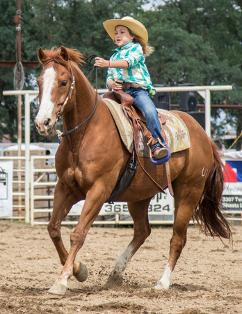 bucking bull: Barrel racing action at the Cottonwood Rodeo in northern California on May 8th, 2016. Editorial
