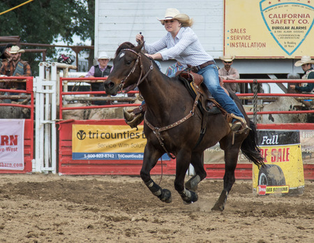cottonwood: Barrel racing action at the Cottonwood Rodeo in northern California on May 8th, 2016. Editorial