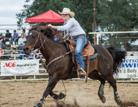 Barrel racing action at the Cottonwood Rodeo in northern California on May 8th, 2016. Editorial