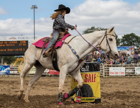 bucking bronco: Barrel racing action at the Cottonwood Rodeo in northern California on May 8th, 2016. Editorial