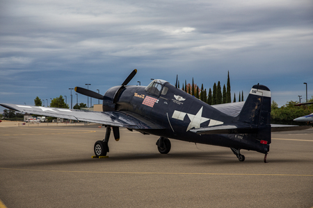 airshow: A f4F Wildcat  belonging to the Commemorative Air Force sits on the runway at dawn during the Redding Airshow.