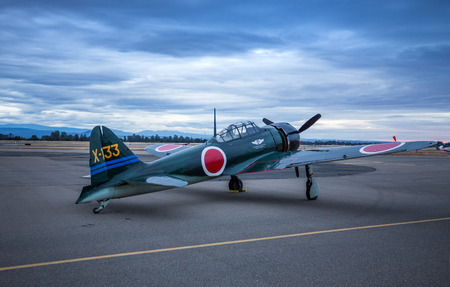 A Japanese Zero belonging to the Commemorative Air Force sits on the runway at dawn during the Redding Airshow.