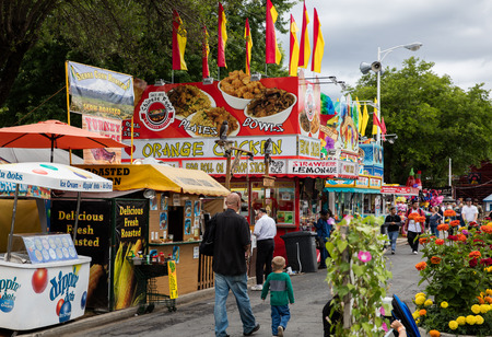 concession: Concession stand, ticket booth, rides, and games at the county fair . Editorial