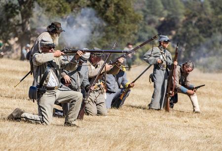 reenactment: Civil War reenactment action at Hawes Farm in Anderson, California.