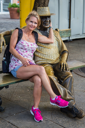 rico: Lovely woman and statue in Old San Juan, Puerto Rico. Editorial