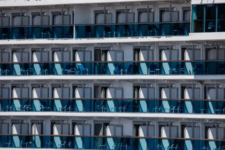 Cruise ship balconies on a large ocean liner.