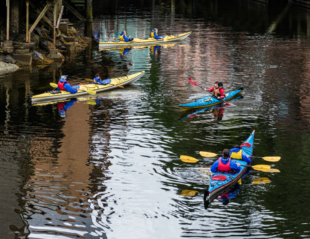 Kayakers below Creek Street in Ketchikan.