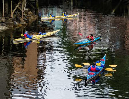 brothel: Kayakers below Creek Street in Ketchikan.
