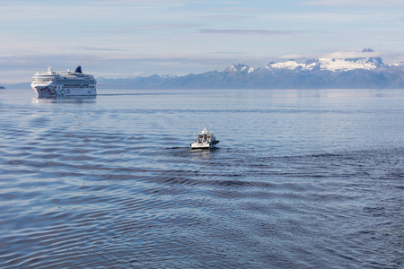 passage: Charter boat  and cruise ship in Alaskas Inner Passage.