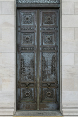 legislature: Bronze doors outside the Inside the state legislature building in Olympia, Washington.