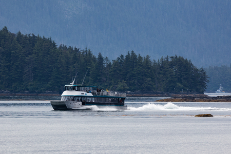 excursion: Excursion  boat with tourists in Sitka, Alaska.