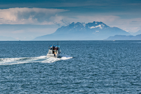 Whale watching boats off Admiralty Island, Alaska.