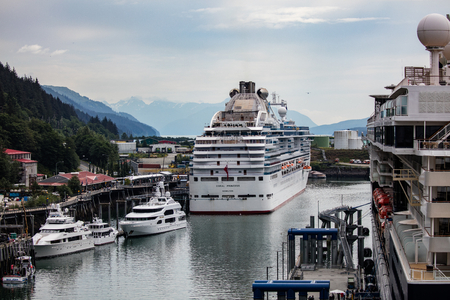 Cruise ship in port at the dock in Juneau, Alaska. Редакционное