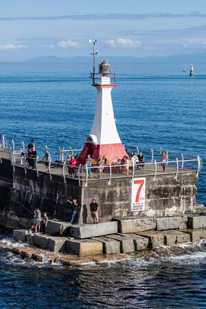 breakwater: Ogden Point Breakwater and Lighthouse, Victoria, Canada.