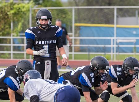 High School football action in Redding, California.