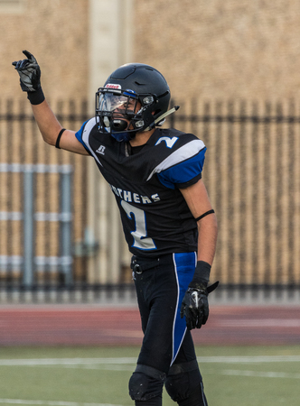 gavilan: la acción del fútbol en la Universidad de la Escuela Secundaria de preparación en Redding, California. Editorial
