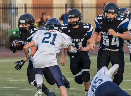 Football action at University Prep High School in Redding, California.